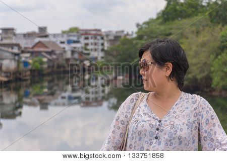 Asia Woman Standing At River Side
