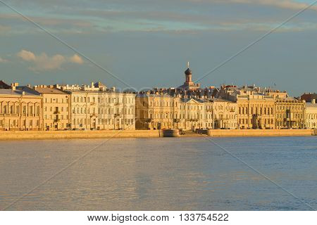 SAINT PETERSBURG, RUSSIA - APRIL 23, 2016: View of the English embankment, lit by the rays of the setting sun. Historical landmark of the city Saint Petersburg
