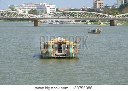 HUE, VIETNAM - JANUARY 08, 2016: Tourist boat on Perfume river in Hue. Tourist landmark of the city Hue, Vietnam