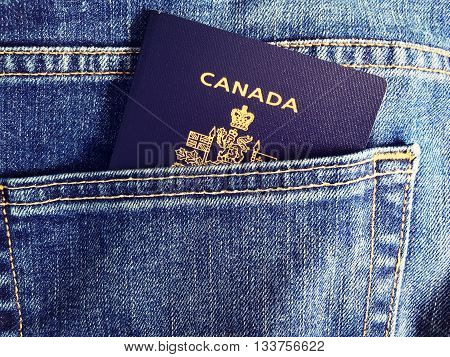 Blue jean pocket with Canadian Passport for travel concept