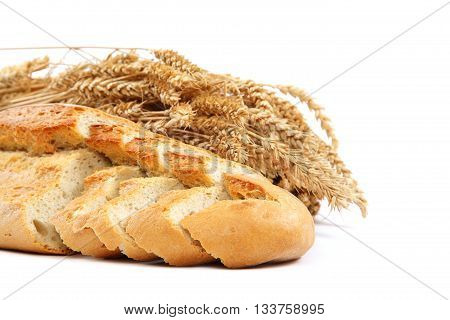 Bread and wheat ears isolated on white background.