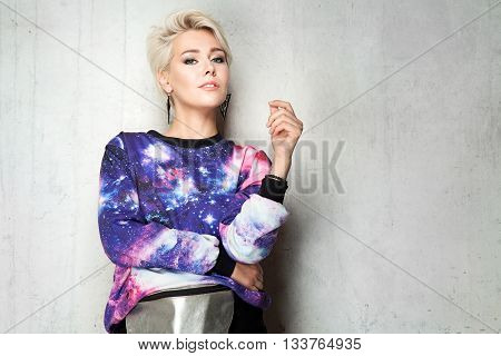 Fashionable Hipster Woman With Short Hair And Silver Bag, Wearing In Sweatshirt With Space Print On