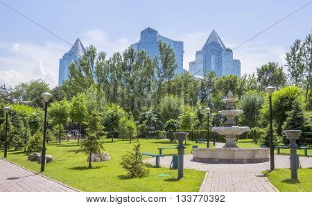 ALMATY KAZAKHSTAN - JUNE 8 2016: Business Center Nurly Tau from the park of the first President. Construction company - Basis A.