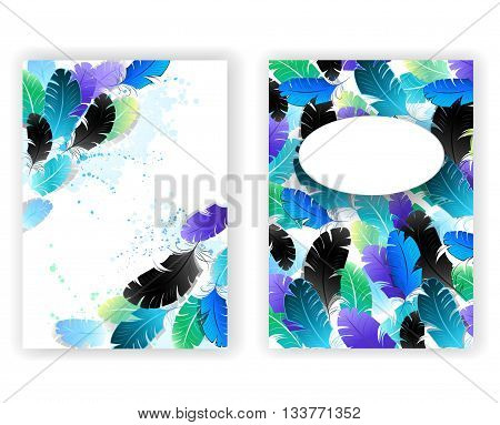 Designed with bright blue green black fluffy feathers on a white background. Design with feathers.