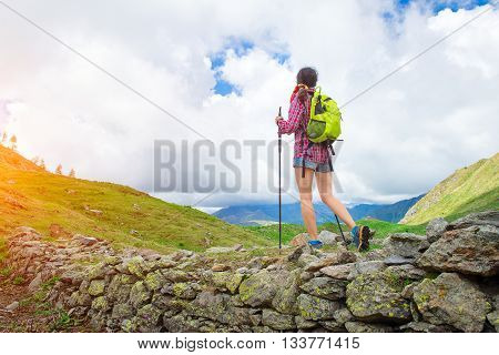Girl Practicing Trekking Alone In The Beautiful Mountain Landscape In Summer