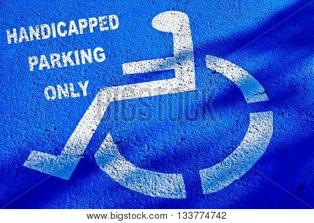 Handicapped Parking Sign on blue surface background