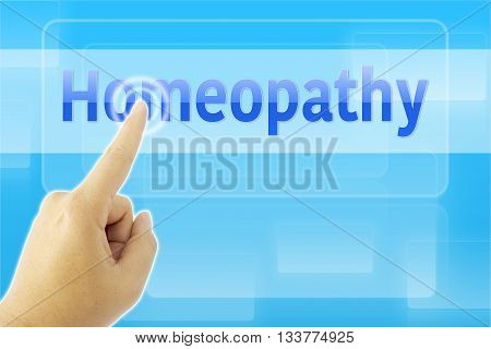 touching Homeopathy sign on blue digital screen