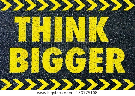 Think Bigger yellow word on road background