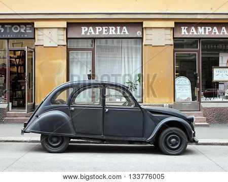 HELSINKI FINLAND - MAY 28 2016: Side view of old small French car at the famous Design District on Pursimiehenkatu street in Helsinki Finland May 28 2016.