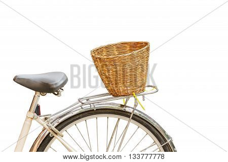 Old vintage bicycle with rattan baskets isolate white background with clipping pah
