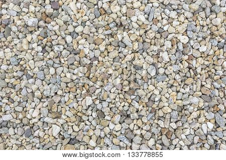 Sea pebbles. Small stones gravel texture background.
