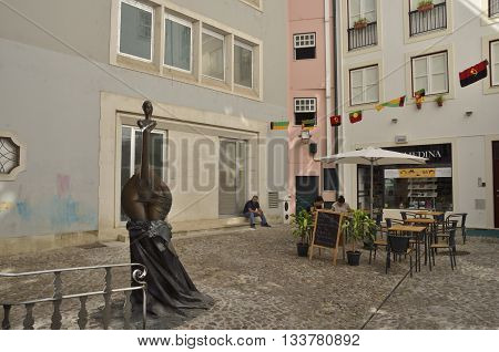 COIMBRA, PORTUGAL - AUGUST 3, 2016: A few people in a quiet plaza of the old city of Coimbra Portugal