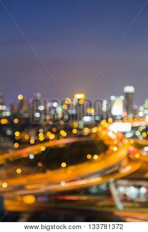 Blurred bokeh lights, Intersection highway and city downtown background, night view