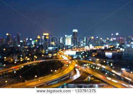 Blurred lights bokeh, Highway intersection and city business downtown background at night. abstract background