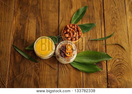 nut tarts , tiramisu and lemon custard desserts on wooden background top view