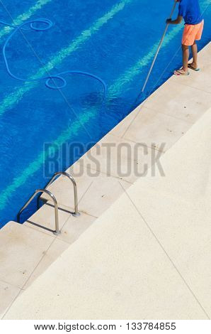 Young Worker Cleaning The Swimming Pool
