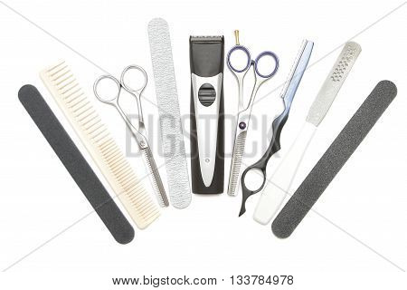 Professional hairdressing manicure and pedicure tools. Comb clip file scissor clippers tweezer and hair trimmer isolated on white background