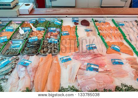 Seafood on ice at the fish market in Amterdam Netherland. Many fish and seafood in shop at market. Fresh seafood and fish in Europe.