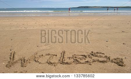 Wales, written in the sand on the beach in Tenby, Wales
