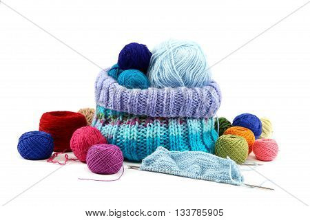 Colored threads and fabric isolated on white background.