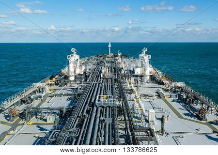 Cargo deck of crude oil tanker in the sea.