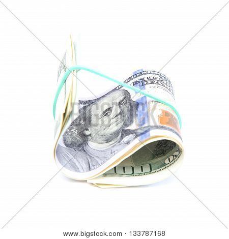 Roll of banknotes isolated on a white background.