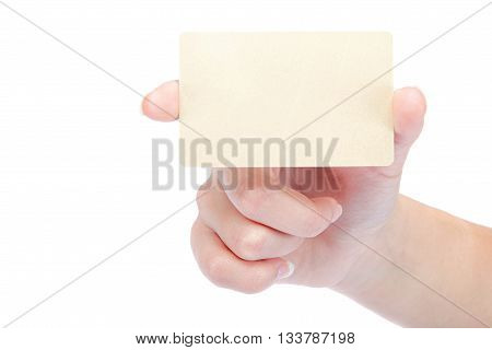 Beautiful female hand holding a gold blank card isolated on a white background.