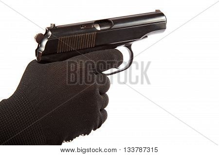 Gun in hand with black gloves isolated on a white background.