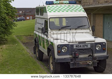 Hastings England - May 21 2016: An old fashioned British ambulance parked outside St John Ambulance Headquarters in Hastings England.