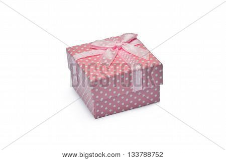 Pink dotted mini present-box with ribbon isolated on white background