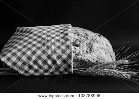 Black and white artisan bread with ears of wheat
