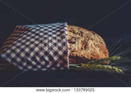 Vintage style: Tilt Shift artisan bread with ears of wheat