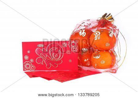 red envelope and orange fruit of chinese new year decoration on white background