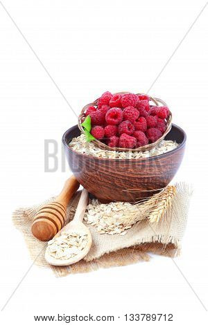 Fresh raspberry and oat flakes isolated on white background. Healthy food.