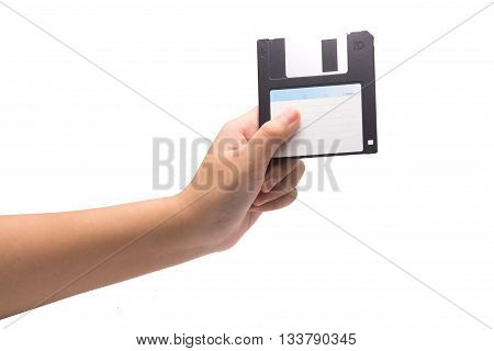 One Human Hand Holding A Black 3.5 Inch Manetic Diskette Isolated On White.