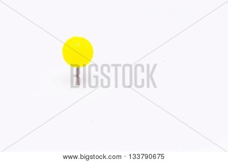 Yellow push pin isolated white background.Yellow push pin