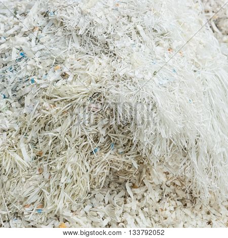 Closeup of shredded white paper documents as background