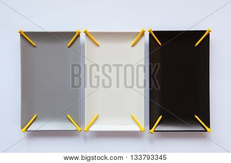 Different ceramic dishes with golf tees on over white background rectangle dish