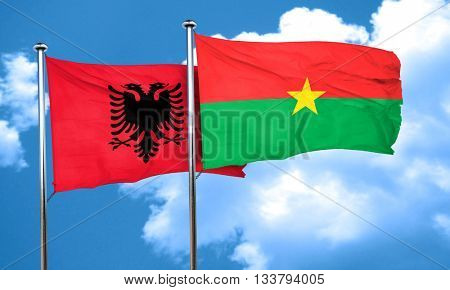 Albania flag with Burkina Faso flag, 3D rendering