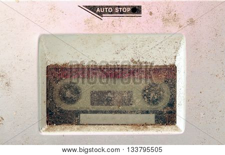 picture of a dusty old cassette player . macro pictures