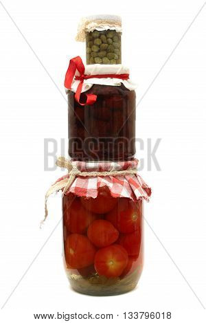 Jar with preserve. Jam pickled tomatoes and capers isolated on white background