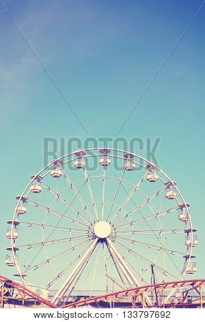 Retro Toned Picture Of An Amusement Park.