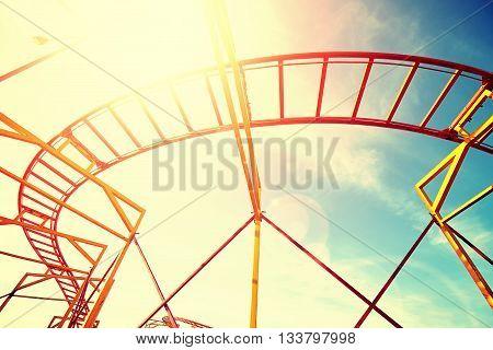 Vintage Toned Roller Coaster Rails Against Sun.