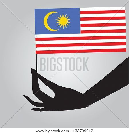 Flag of Malaysia in a female hand. Vector illustration.