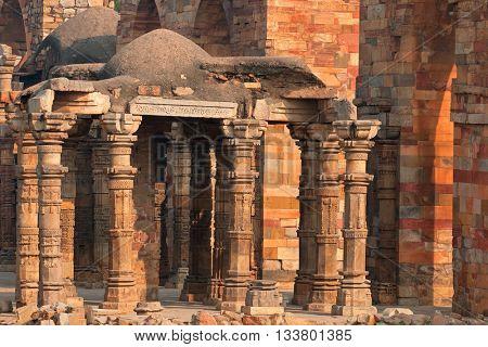 Old sandstone pillars at the Qutb Minar complex in Delhi, India