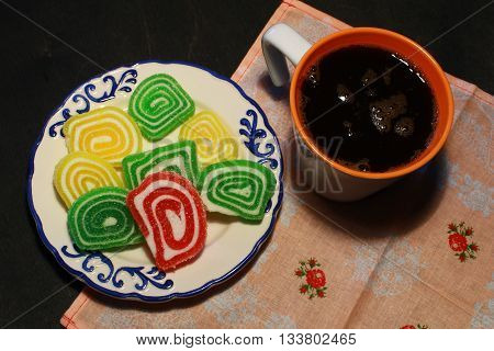 Colorful Candies, Jelly And Marmalade Heart And Coffee Cup On Wood Background.