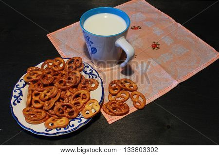 A Healthy Breakfast: Tasty Pretzels With A Cap Of Milk.