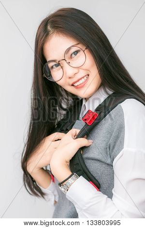Portrait Of Beautiful Asian College Student With Notebook Bag