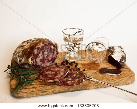 Salami, sausage and grappa is always a delicious meal.