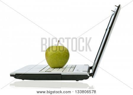 apple lying on a keyboard